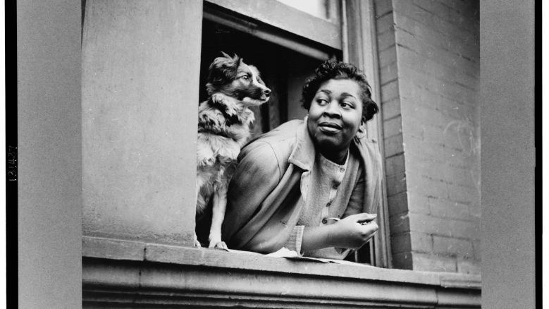 A woman and her dog in Harlem (1943)